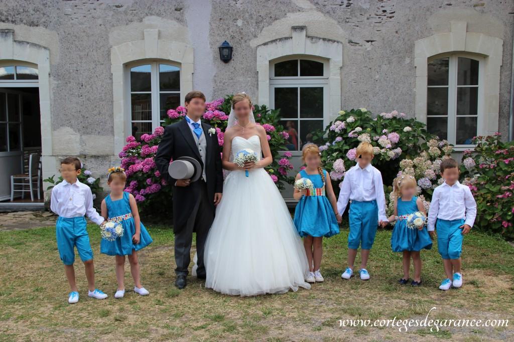Cortège Bertille: robe boule turquoise et ceinture à pois